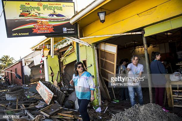 Residents remove debris at Tongoy sea ressort 400 kilometres north of Santiago hit by an earthquake on the eve on September 17 2015 Rattled Chileans...