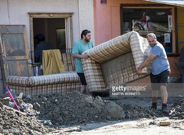 Residents remove furniture at Tongoy sea ressort 400 kilometres north of Santiago hit by an earthquake on the eve on September 17 2015 Rattled...