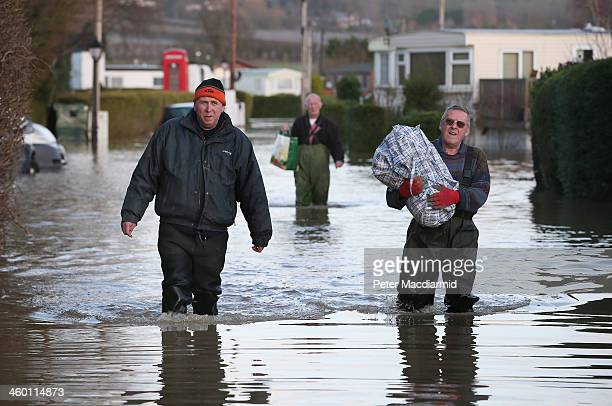 Residents Rescue Possesions From Flooded Caravans At The Little Venice Country Park On January 2 2014