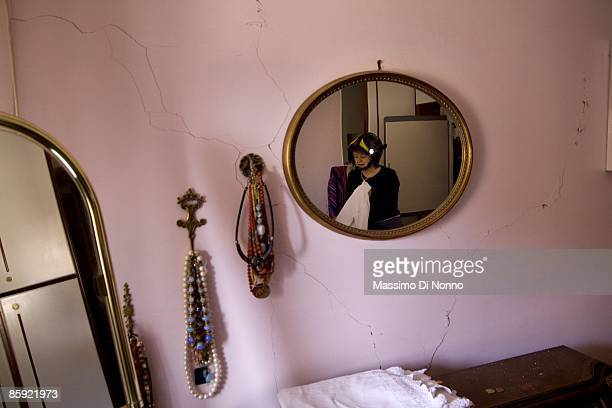 L' AQUILA APRIL 13 Residents return to their earthquakedamaged homes to recover personal possessions on April 13 2009 in L'Aquila Italy Recovery and...