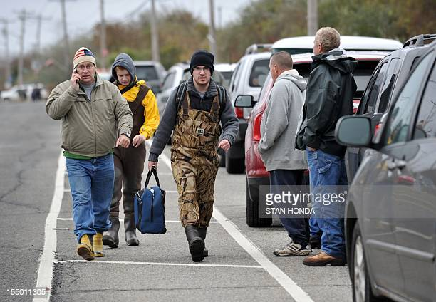 Residents return to their homes on October 30 2012 in the Breezy Point area of Queens in New York that was hit hard by Hurricane Sandy The death toll...