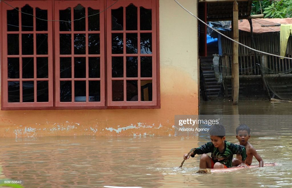 Residents save themselves from floods at Pangkalan village on February 09, 2016 in Lima Puluh Koto regency, West Sumatra Province, Indonesia. More 1000 houses submerged, 5000 residents were evacuated.