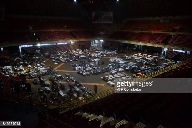 Residents seek shelter inside Roberto Clemente Coliseum in San Juan Puerto Rico early on September 20 as Hurricane Maria passes the island Hurricane...