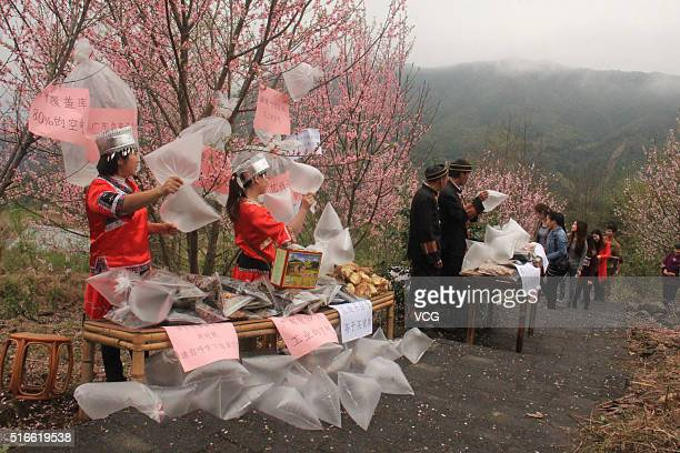 Residents sell clean air to visitors in north area of Guangdong Province where mountains surround with clean air on March 19 2016 in Qingyuan...