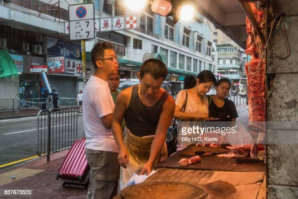 Residents shop in wet market as typhoon Hato hits Hong Kong on August 23 2017 in Hong Kong Hong Kong Hong Kong's weather authorities raised Typhoon...