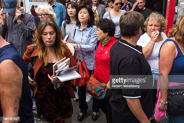 Residents shoppers and tourists congregate on a street corner in Soho September 14 2013 in the Manhattan borough of New York