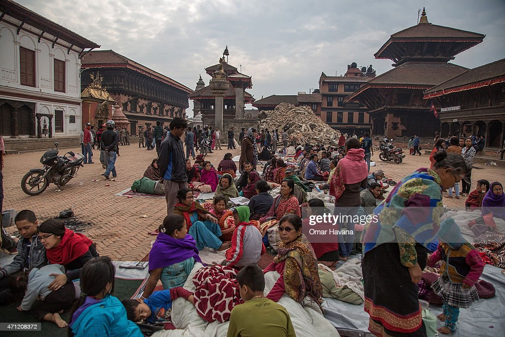 Residents sit in a square on April 26 2015 in Bhaktapur Nepal A major 78 earthquake hit Kathmandu midday on Saturday and was followed by multiple...