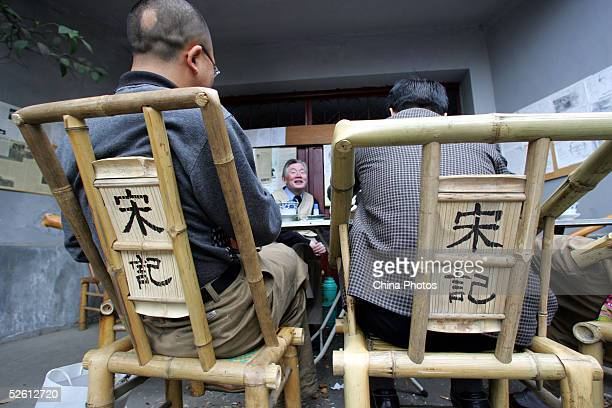 Residents sitting on bamboomade chairs enjoy tea outdoors at the Zhaixiangzi Alley on April 9 2005 in Chengdu of Sichuan Province China The...