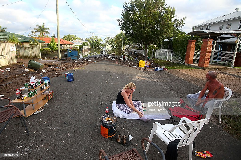 Residents sleep in their street to prevent looters as parts of southern Queensland experiences record flooding in the wake of Tropical Cyclone Oswald on January 30, 2013 in Bundaberg, Australia. Flood waters peaked at 9.53 metres in Bundaberg yesterday and began receding overnight, as residents and relief teams prepare to clean-up debris. Four deaths have been confirmed in the Queensland floods and the search is on for two men though to be missing in floodaters in Gatton.