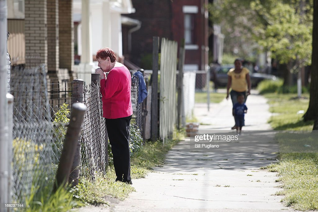 Residents stand along Seymour Avenue across the street from the house where three women, who disappeared as teens about a decade ago, were found alive May 7, 2013 in Cleveland, Ohio. Amanda Berry, who went missing in 2003, Gina DeJesus, who went missing in 2004, and Michelle Knight, who went missing in 2002, managed to escape their captors on May 6, 2013. Three suspects, all brothers, were taken into custody.