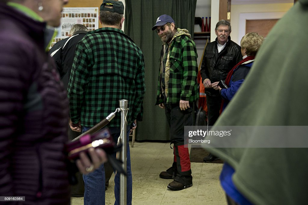 Residents stand in a line to receive a ballot at the Bartlett town hall during the first-in-the-nation New Hampshire presidential primary in Bartlett, New Hampshire, U.S., on Tuesday, Feb. 9, 2016. Polls suggest that Donald Trump maintains a dominant lead against his Republican rivals in New Hampshire ahead of today's primary. Photographer: Andrew Harrer/Bloomberg via Getty Images