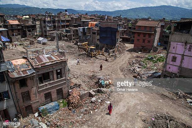 Residents stand in a square where all houses were damaged or collapsed after the earthquake that hit Nepal on July 29 2015 in Bhaktapur Nepal Three...