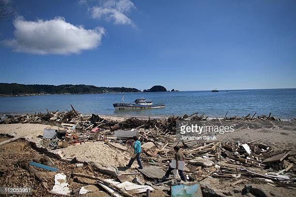 Residents survey the damage of Dichato a small fishing village completely destroyed by an 88 magnitude earthquake and subsequent tsunami the previous...