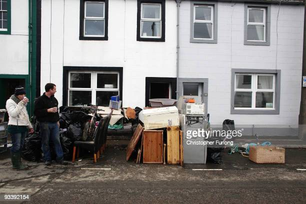 Residents survey their water damaged belongings in the wake of last weeks devastating floods in Cumbria on November 25 2009 in Cockermouth England An...