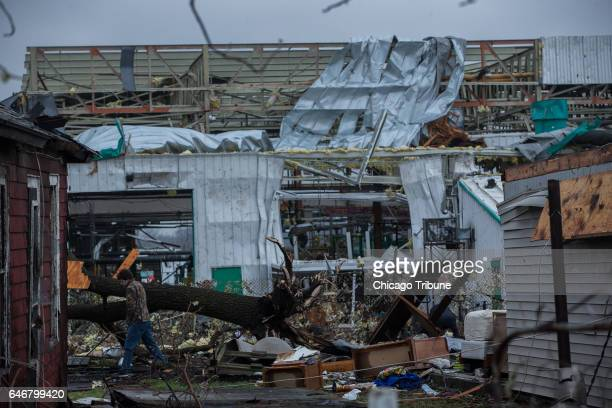 Residents survey tornado damage on Wednesday March 1 2017 in Naplate Ill