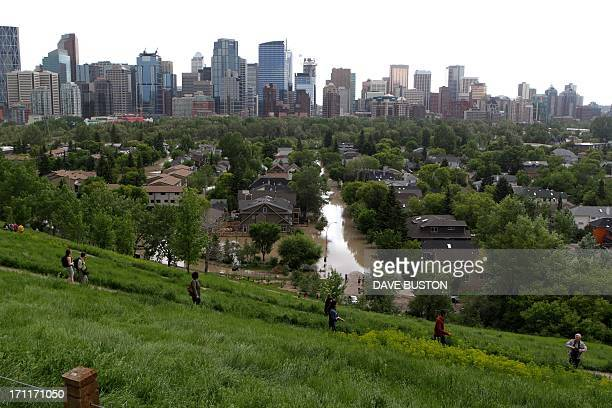 Residents take a higher ground to watch the flood situation near the flooded Bow River in CalgaryAlberta Canada June 22 2013 Water levels have...