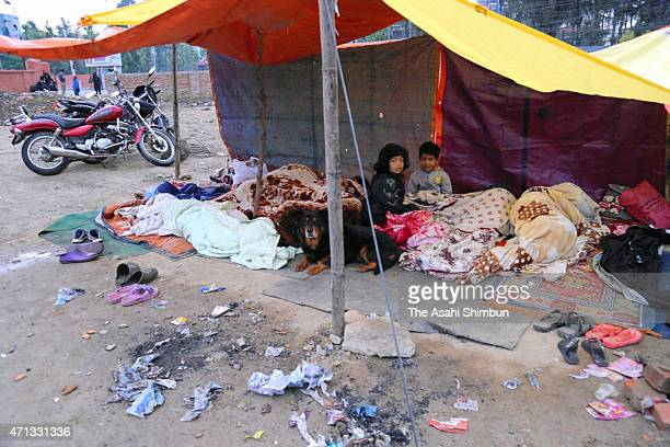 Residents take shelter in a open space inside a school on April 26 2015 in Kathmandu Nepal A major 78 earthquake hit Kathmandu midday on Saturday and...