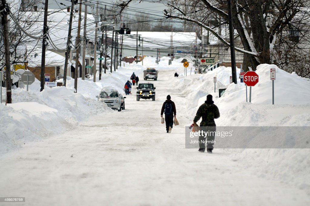 Residents take to the street for supplies along Lake Avenue on November 20 2014 in the suburb of Blasdell Buffalo New York The record setting Lake...