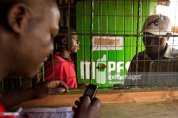 Residents transfer money using the MPesa banking service at a store in Nairobi Kenya on Sunday April 14 2013 In the six years since Kenya's MPesa...