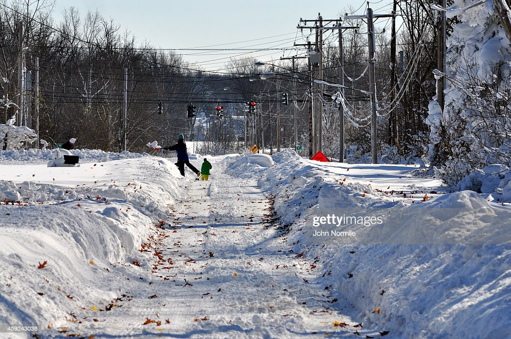 Residents try to shovel through nearly five feet of snow on November 19 2014 in the Lakeview neighborhood of Buffalo New York The record setting Lake...