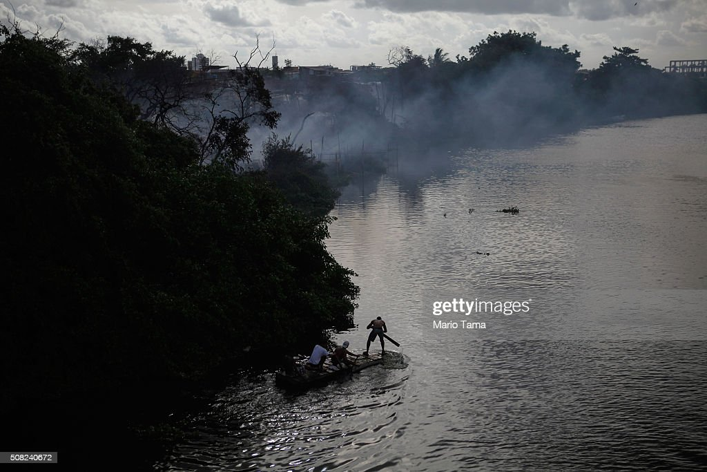 Residents use a makeshift boat as they prepare to recover items from a nearby fire which destroyed many wooden makeshift homes along the polluted Capibaribe River on February 3, 2016 in Recife, Pernambuco state, Brazil. Officials say as many as 100,000 people may have already been exposed to the Zika virus in Recife, many from poorer communities, although most never develop symptoms. The state with the most cases is Pernambuco, whose capital is Recife, and is being called the epicenter of the outbreak. In the last four months, authorities have recorded thousands of cases in Brazil in which the mosquito-borne Zika virus may have led to microcephaly in infants. Microcephaly results in an abnormally small head in newborns and is associated with various disorders.