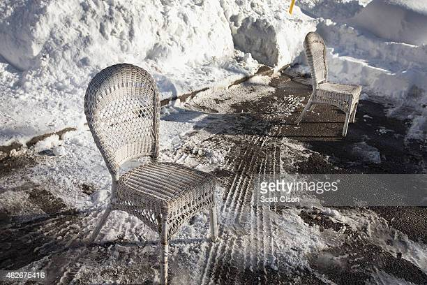 Residents use chairs to reserve a parking spot on the street after digging a car out of snow on February 2 2015 in Chicago Illinois Snow began...
