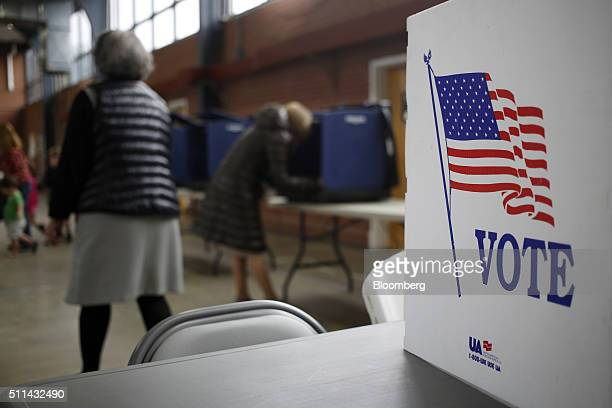 Residents vote in the South Carolina Republican presidential primary election at a polling station inside the South Carolina National Guard armory in...