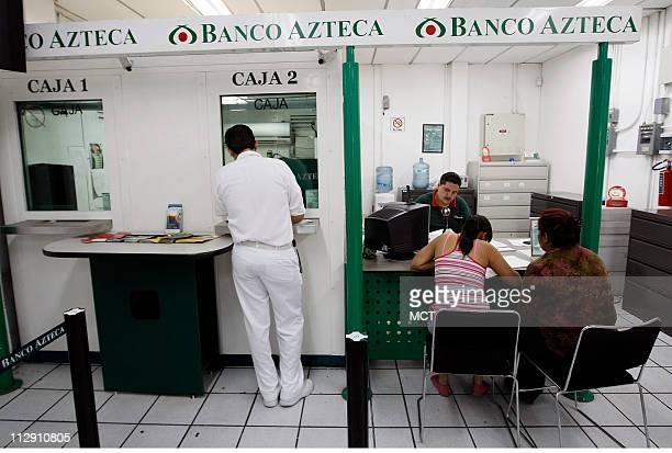 Residents wait in line at the Banco Azteca banking outlet in Zamora Michoacan that handles Western Union wire transfers from the US A large majority...