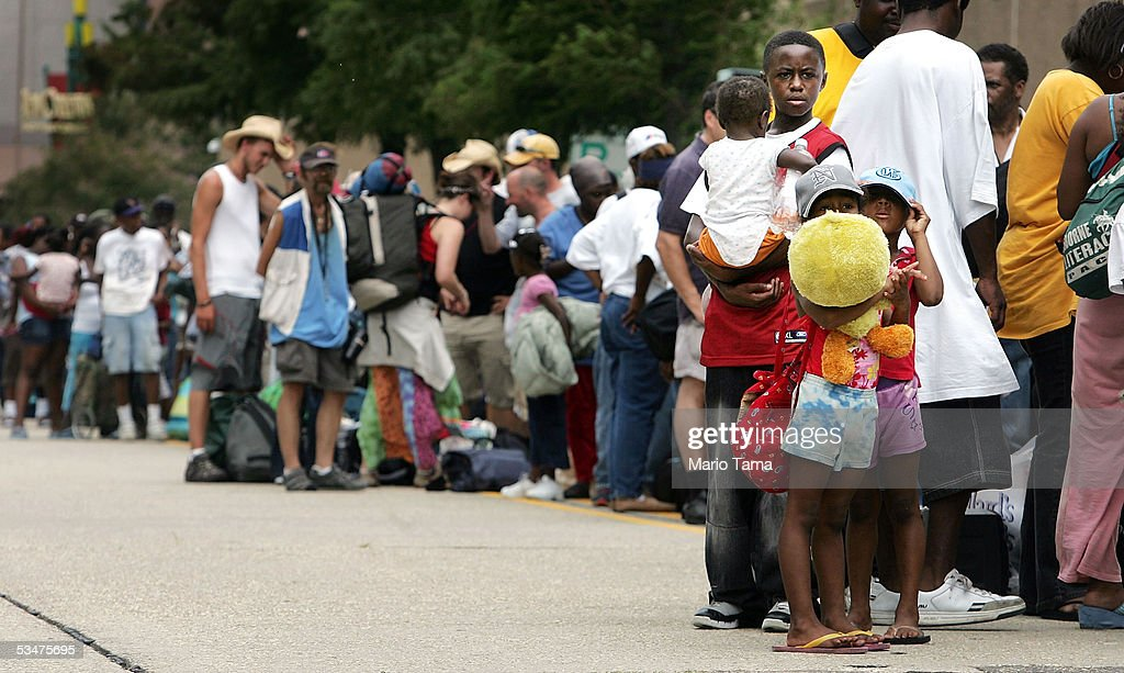 Residents wait in line to enter the Superdome which is being used as an emergency shelter before the arrival of Hurricane Katrina August 28, 2005 in New Orleans, Louisiana. Hurricane Katrina has sustained winds of 175 mph and is expected to make landfall in the Gulf Coast as early as August 29. A state of emergency has been declared for Louisiana as the Category 5 storm approaches.