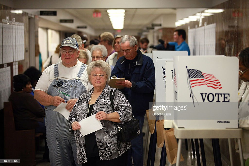 Residents wait in line to pick up a ballot during early voting at the Black Hawk County Courthouse on September 27, 2012 in Waterloo, Iowa. Early voting starts today in Iowa where in the 2008 election 36 percent of voters cast an early ballot.