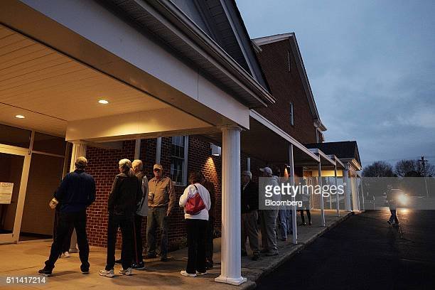 Residents wait in line to vote in the South Carolina Republican presidential primary election before the polls open at the Cross Roads Baptist Church...