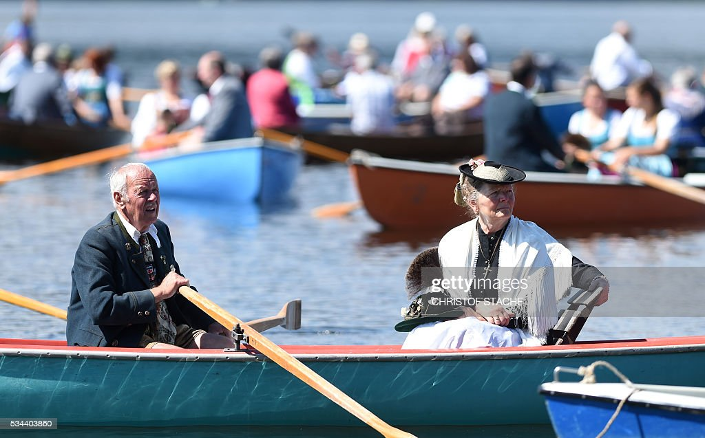 Residents wait in their boat as they take part in a Corpus Christi procession at the lake Staffelsee in Seehausen near Murnau, southern Germany, on May 26, 2016. / AFP / CHRISTOF
