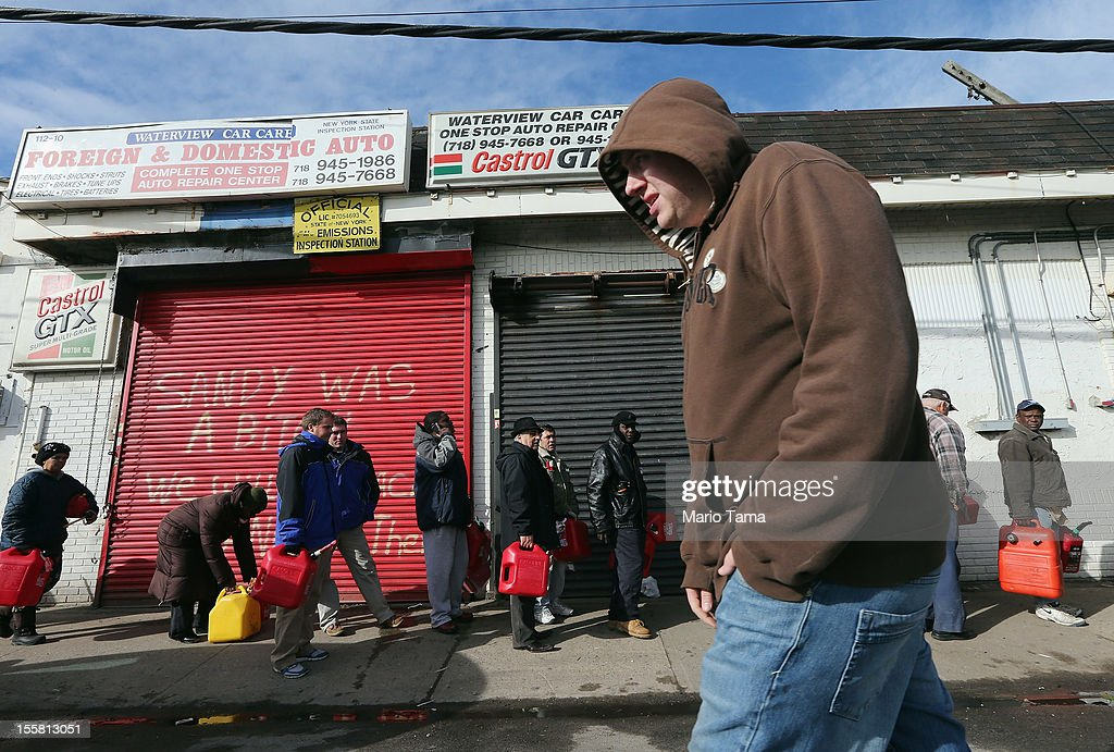 Residents wait on line to collect free gasoline the day after a Nor'Easter storm in the aftermath of Superstorm Sandy on November 8, 2012 in the Rockaway neighborhood of the Queens borough of New York City. Today was the first day gasoline became available for residents in the neighborhood following Sandy. Many of the residents are using gasoline to power generators for electricity. The Nor'Easter brought gusting winds, rain, and snow and forced the cancelation of flights for thousands of passengers flying into and out of JFK, LaGuardia and Newark.