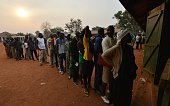 TOPSHOT Residents wait to cast their vote at the polling station on December 30 2015 in the country's presidential and legislative in the Muslim...