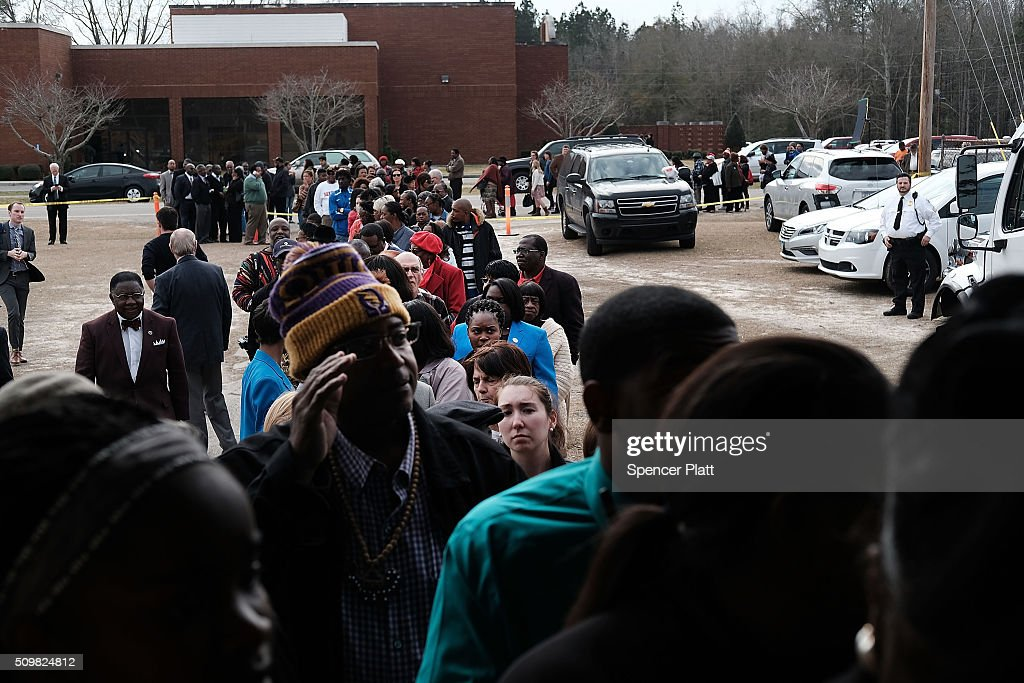 Residents wait to get into a school to see Democratic presidential candidate Hillary Clinton speak in South Carolina a day after her debate with rival candidate Bernie Sanders on February 12, 2016 in Denmark, South Carolina. Clinton is counting on strong support from the African American community in South Carolina to give her a win over Sanders in the upcoming primary on February 27.
