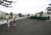 Residents walk at the site where Portuguese footballer Cristiano Ronaldo was born at Bairro Quinta Falcao in Funchal Madeira Island on June 24 2009...