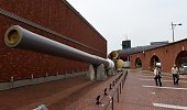 Residents walk beside the 1920made battleship Mutsu's screw propeller and the 76metrelong200tonne submarine Akishio which served at the Japan's...