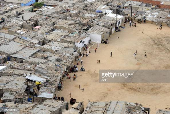 Residents walk in the shanty town of Boa Vista in Luanda on December 21 2009 The OPEC oil producers' cartel will hold output quotas unchanged at its...