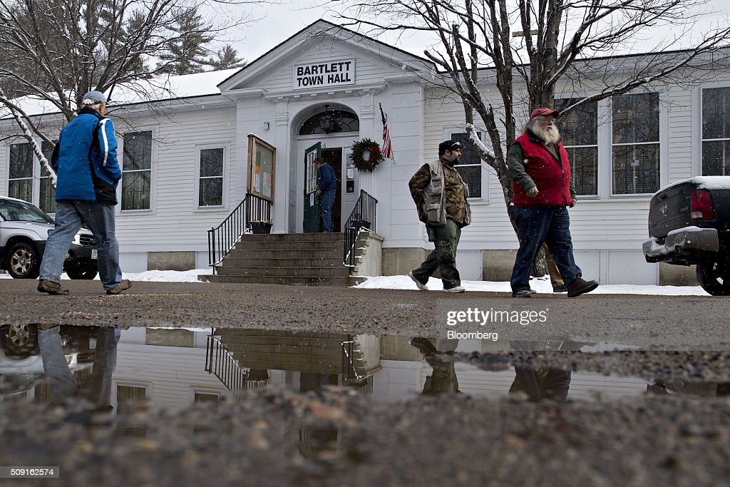 Residents walk out of the Bartlett town hall after voting during the first-in-the-nation New Hampshire presidential primary in Bartlett, New Hampshire, U.S., on Tuesday, Feb. 9, 2016. Polls suggest that Donald Trump maintains a dominant lead against his Republican rivals in New Hampshire ahead of today's primary. Photographer: Andrew Harrer/Bloomberg via Getty Images