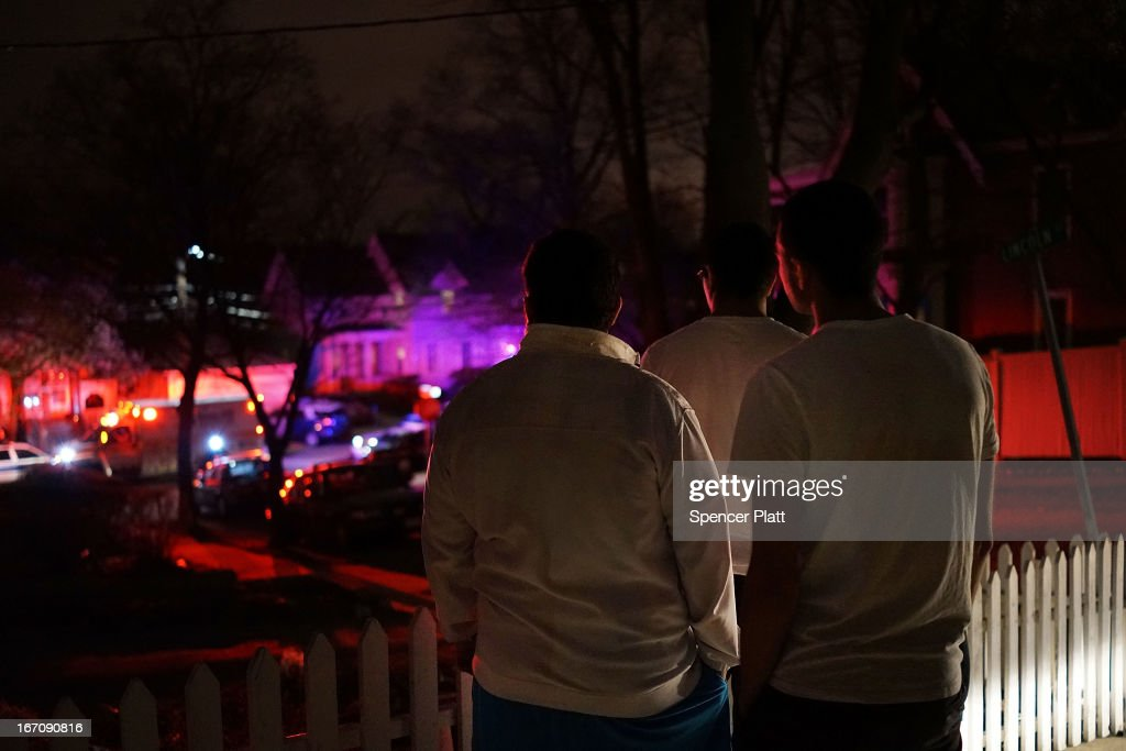 Residents watch events moments after 19-year-old bombing suspect Dzhokhar A. Tsarnaev was apprehended on April 19, 2013 in Watertown, Massachusetts. A manhunt for Boston Marathon bombing suspect Tsarnaev ended this evening with his capture on a boat parked on a residential property in Watertown, Massachusetts. His brother Tamerlan Tsarnaev, 26, the other suspect, was shot and killed by police early this morning after a car chase and shootout with police. The two men are suspects in the bombings at the Boston Marathon on April 15 that killed three people and wounded at least 170.