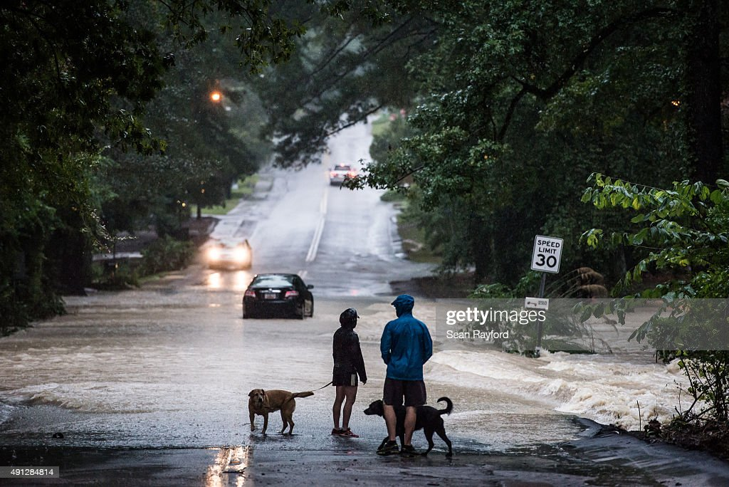 Residents watch rising flood waters October 4 2015 in Columbia South Carolina South Carolina experienced a record rainfall with at least 115 inches...