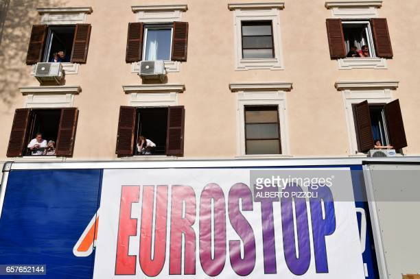 Residents watch the cortege from the windows of their appartments during a demonstration against the European Union on March 25 2017 in Rome Italian...