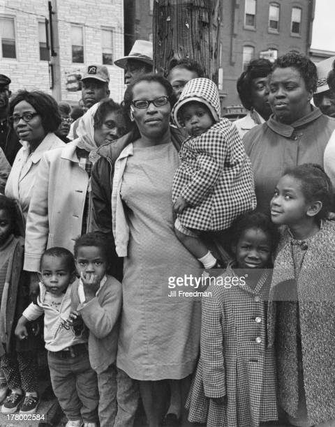 Residents watch the demonstrators pass through their town on the route of the Poor People's Campaign march to Washington DC May 1968 The Poor...
