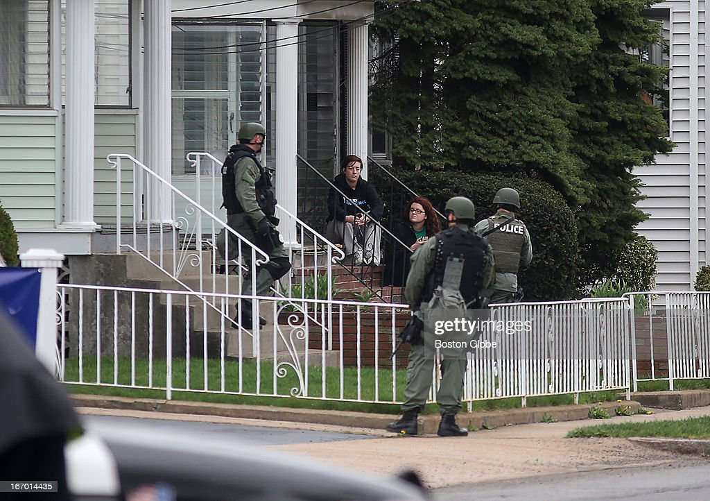 Residents watch the ongoing manhunt for a suspect in the terrorist bombing of the 117th Boston Marathon earlier this week Watertown is on lockdown...