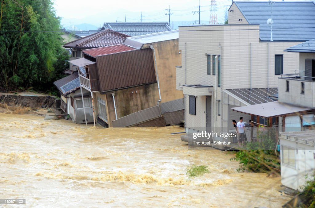 Residents watch the swollen Konze River triggered by typhoon Man-Yi approaching on September 16, 2013 in Ritto, Shiga, Japan. The storm hit land near Toyohashi, Aichi Prefecture, before 8 a.m. and moved along Honshu throughout the day, damaging buildings, disrupting transportation and causing blackouts, three killed and five missing.
