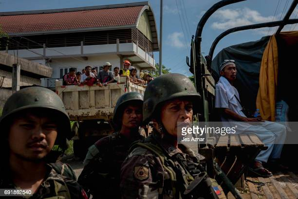 Residents who escaped from the inner city being sieged by militants are transported to safer grounds on June 3 2017 in Marawi City southern...
