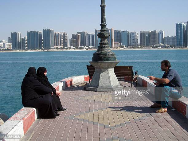 Residents who live in Abu Dhabi the capital of the United Arab Emirates spend long afternoons at the relatively undeveloped beachfront Abu Dhabi is...