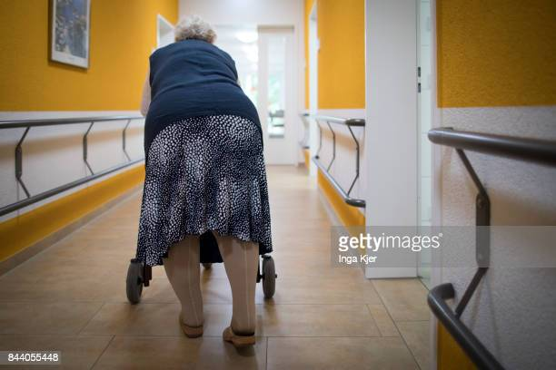 A residents with a walker walks down the hall way in a retirement home on August 08 2017 in EberswaldeFinow Germany