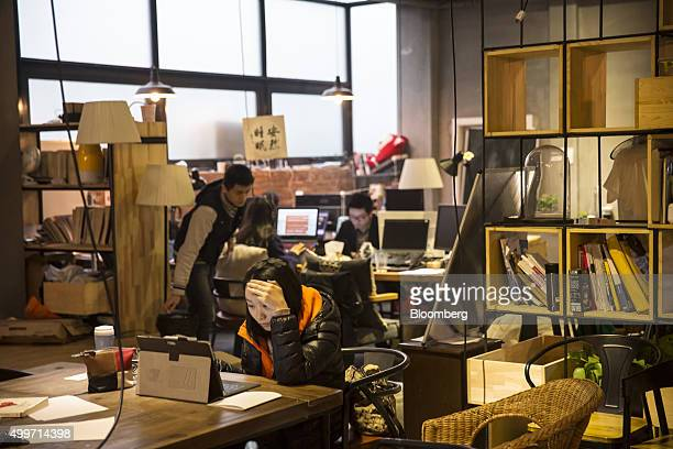 Residents work at their laptop computers inside a You community in Beijing China on Monday Nov 30 2015 Nearly 5000 people across China have moved...