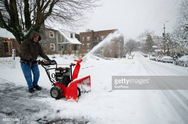Residents work on snow removal as Philadelphia PA is hit by Winter Storm Stella on March 14 2017 Ice accumulation impacts the region as a Winter...